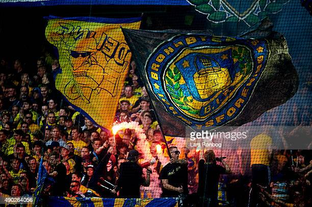Fans of Brondby IF cheer with pyrotechnics during the Danish Alka Superliga match between Brondby IF and FC Copenhagen at Brondby Stadion on...