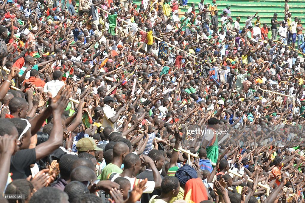Fans of Burkina Faso's national football team cheer their players on February 12, 2013 at the Stade du 4-août in Ouagadougou, two days after they lost the final football match of the 2013 Africa Cup of Nations against Nigeria.