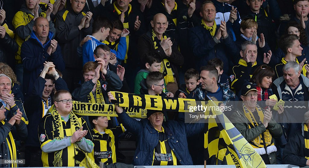 Fans of Burton Albion during the Sky Bet League One match between Burton Albion and Gillingham at Pirelli Stadium on April 30, 2016 in Burton-upon-Trent, England.
