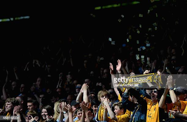Fans of Cambridge United show their colours during the Skrill Conference Premier PlayOffs SemiFinal match between Cambridge United and Halifax Town...