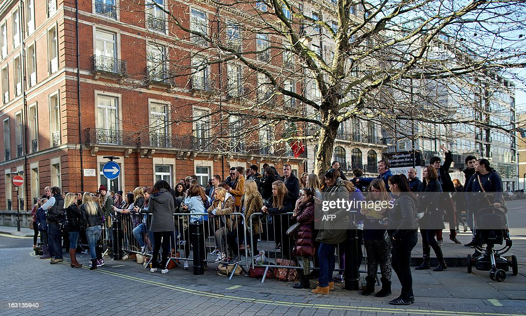 Fans of Canadian singer Justin Bieber gather outside his hotel in central London, on March 5, 2013. Teen superstar Justin Bieber faced fury from his British fans on Tuesday after he showed up late for a sold-out concert in London. The Canadian singer played the first of four nights at London's O2 Arena on Monday, but hundreds in the audience took to Twitter to vent their frustration after he failed to appear on stage until nearly 10:30 pm.
