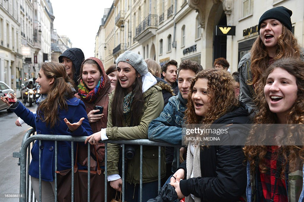Fans of Canadian singer Justin Bieber gather outside his hotel on March 18, 2013 in Paris, on the eve of his concert for the 'I Believe' tour at the Palais Omnisport de Paris-Bercy (POPB). Within a few days, the 19-year-old pop sensation angered some of his fans for being late on stage, then cancelled his March 5 Lisbon concert after suffering a health scare and was involved in a foul-mouthed confrontation with a photographer.