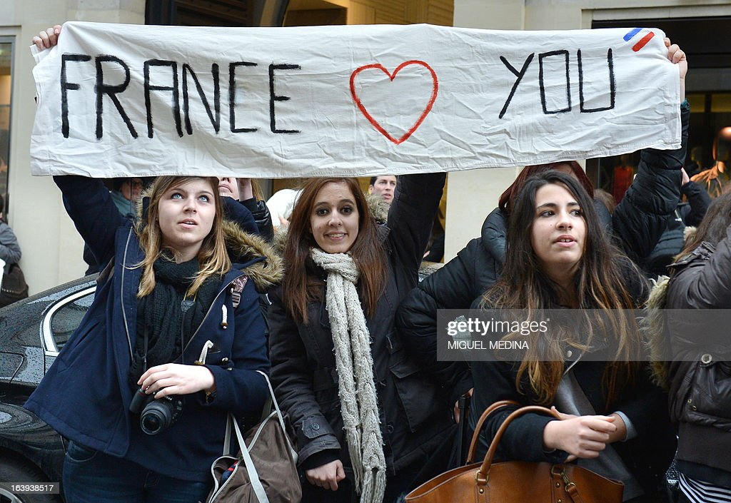 Fans of Canadian singer Justin Bieber hold a banner reading 'France loves you' as they gather outside his hotel on March 18, 2013 in Paris, on the eve of his concert for the 'I Believe' tour at the Palais Omnisport de Paris-Bercy (POPB). Within a few days, the 19-year-old pop sensation angered some of his fans for being late on stage, then cancelled his March 5 Lisbon concert after suffering a health scare and was involved in a foul-mouthed confrontation with a photographer.