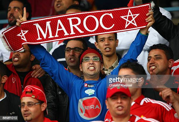 Fans of Casablanca celebrate their team during the Zayon Cup match between Al Ahly and Wydad AC Casablanca at the Lorheide stadium on July 11 2009 in...