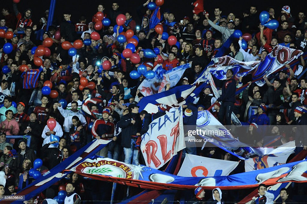 Fans of Cerro Poteno cheer for their team during a second leg match between Boca Juniors and Cerro Porteno as part of round of sixteen of Copa Bridgestone Libertadores 2016 at Alberto J Armando Stadium on May 05, 2016 in Buenos Aires, Argentina.