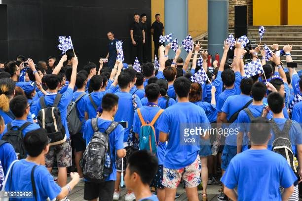 Fans of Chelsea FC wave flags at an activity ahead of the PreSeason Friendly match between Chelsea and Arsenal on July 20 2017 in Beijing China