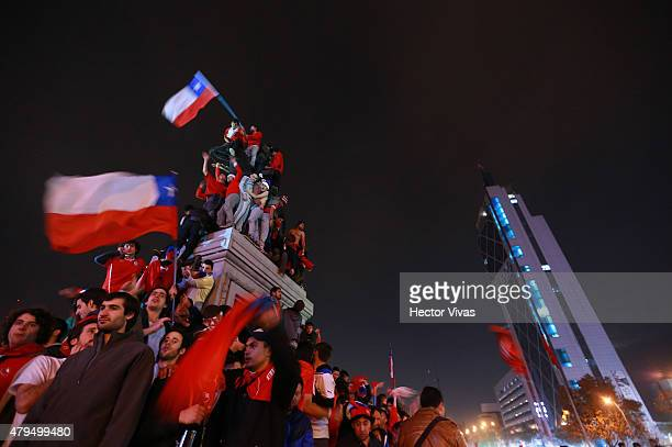 Fans of Chile celebrate their team's victory at Plaza Italia following the 2015 Copa America Chile Final match between Chile and Argentina on July 04...