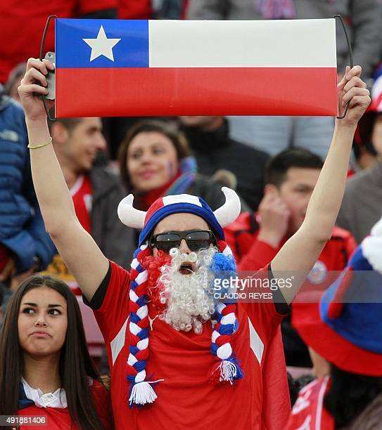Fans of Chile cheer for their team before the start of the Russia 2018 FIFA World Cup qualifiers match Chile vs Brazil at the Nacional stadium in...