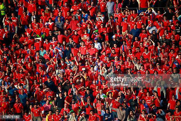 Fans of Chile cheer for their team during the 2015 Copa America Chile Final match between Chile and Argentina at Nacional Stadium on July 04 2015 in...