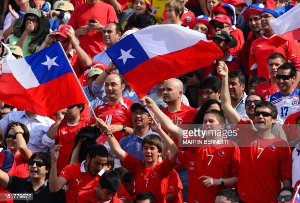Fans of Chile's football team wave flags before the start of their Brazil 2014 FIFA World Cup South American qualifier match against Colombia held at...
