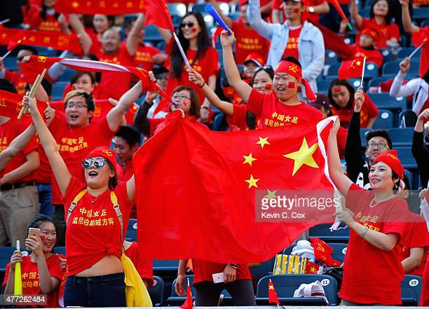 Fans of China PR cheer prior to the FIFA Women's World Cup Canada 2015 Group A match between China PR and New Zealand at Winnipeg Stadium on June 15...