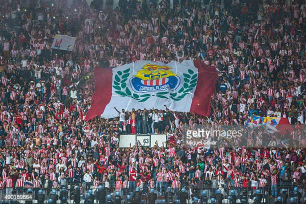 Fans of Chivas cheer for their team during a 10th round match between America and Chivas as part of the Apertura 2015 Liga MX at Azteca Stadium on...