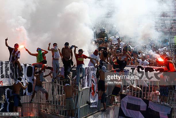 Fans of Colo Colo cheer for their team prior a match between U de Chile and Colo Colo as part of Campeonato Clausura 2016 at Nacional Stadium on...