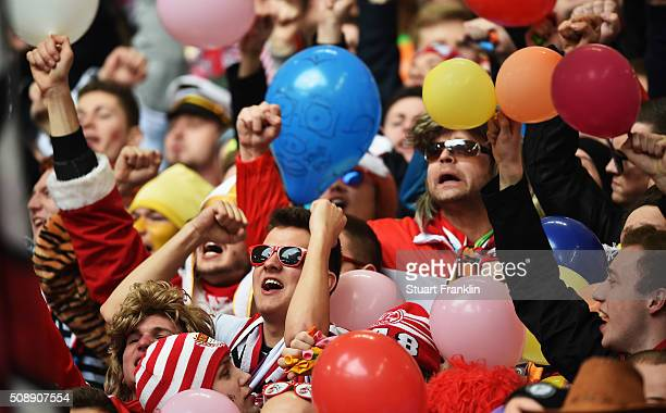 Fans of Cologne dressed in carnival costumes watch during the Bundesliga match between Hamburger SV and 1 FC Koeln at Volksparkstadion on February 7...