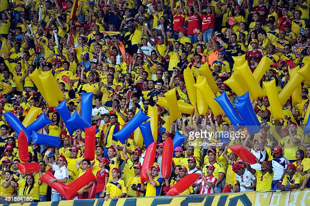 Fans of Colombia cheer for their team prior to a match between Colombia and Peru as part of FIFA 2018 World Cup Qualifier at Metropolitano Roberto...