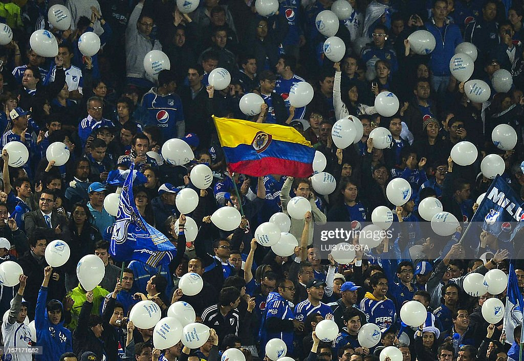 Fans of Colombian Millonarios cheer for their team before their 2012 Copa Sudamericana semifinal football match against Argentine Tigres at El Campin stadium in Bogota on November 29, 2012. AFP PHOTO / Luis Acosta