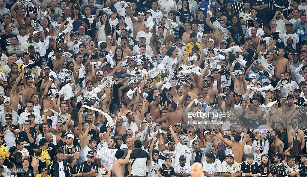 Fans of Corinthians celebrates during the match between Corinthians and Internacional for the Brazilian Series A 2014 at Arena Corinthians on July 17, 2014 in Sao Paulo, Brazil.