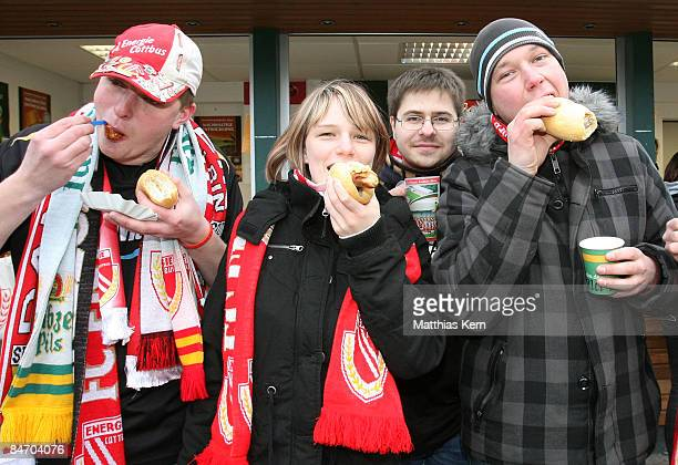 Fans of Cottbus eat fried sausage and curried sausage prior to the Bundesliga match between FC Energie Cottbus and Hannover 96 at the Stadion der...