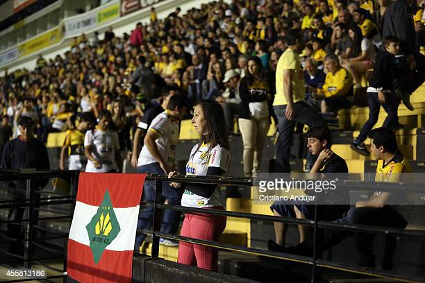 Fans of Criciuma arriving at stadium before a match between Criciuma and Botafogo as part of Campeonato Brasileiro 2014 at Heriberto Hulse Stadium on...