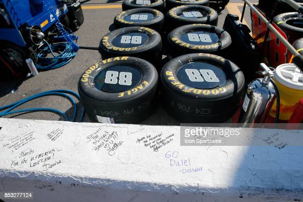Fans of Dale Earnhardt Jr Monster Energy NASCAR Cup Series driver of the Nationwide Chevrolet sign the pit wall during Monster Energy Cup Series ISM...