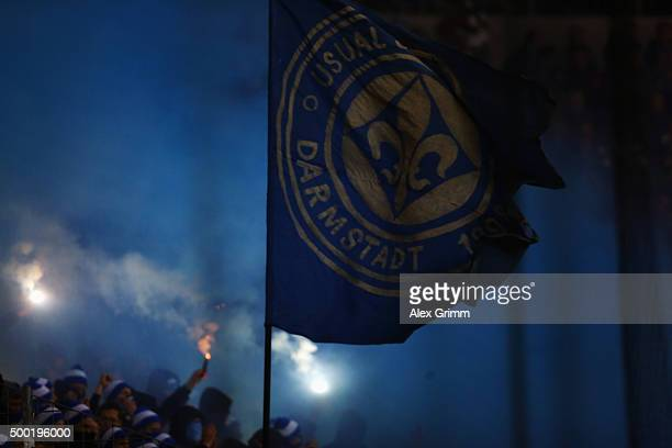 Fans of Darmstadt burn flares during the Bundesliga match between Eintracht Frankfurt and SV Darmstadt 98 at CommerzbankArena on December 6 2015 in...