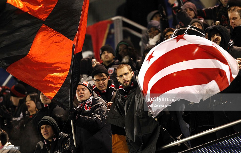 Fans of D.C. United cheer from the upper deck as the team salutes them from the field after their Eastern Conference Semifinal match against the New York Red Bulls was postponed due to weather conditions at Red Bull Arena on November 7, 2012 in Harrison, New Jersey.