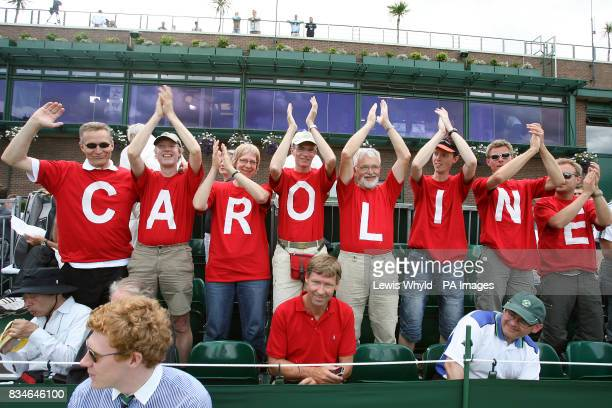 Fans of Denmark's Caroline Wozniacki display their support during the Wimbledon Championships 2008 at the All England Tennis Club in Wimbledon