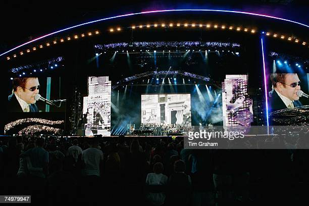 Fans of Diana Princess of Wales watch Sir Elton John performing on stage at the 'Concert for Diana' at Wembley Stadium which the Princes organised to...