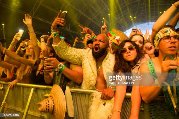 Fans of DJ Khaled dance during his performance at the Coachella Valley Music And Arts Festival on April 16 2017 in Indio California / AFP PHOTO /...