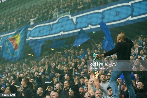 Fans of Djurgardens IF burns Hammarby scarf during the Allsvenskan match between Hammarby IF and Djurgardens IF at Tele2 Arena on June 4 2017 in...