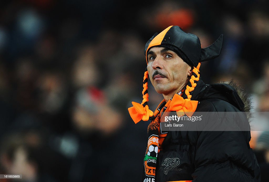 Fans of Donetsk are seen during the UEFA Champions League Round of 16 first leg match between Shakhtar Donetsk and Borussia Dortmund at Donbass Arena on February 13, 2013 in Donetsk, Ukraine.