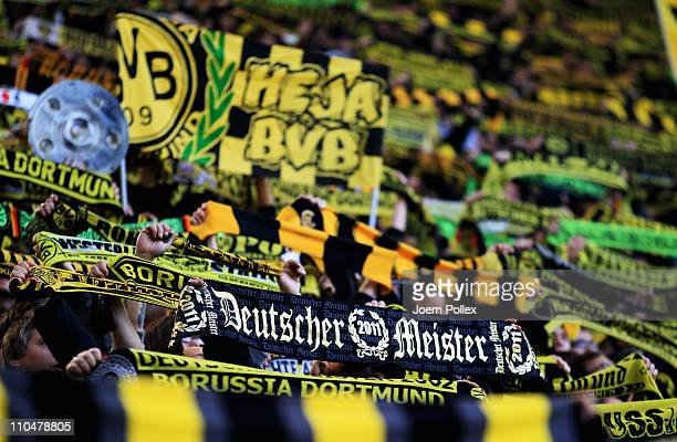 Fans of Dortmund are celebrating prior to the Bundesliga match between Borussia Dortmund and FSV Mainz 05 at Signal Iduna Park on March 19 2011 in...