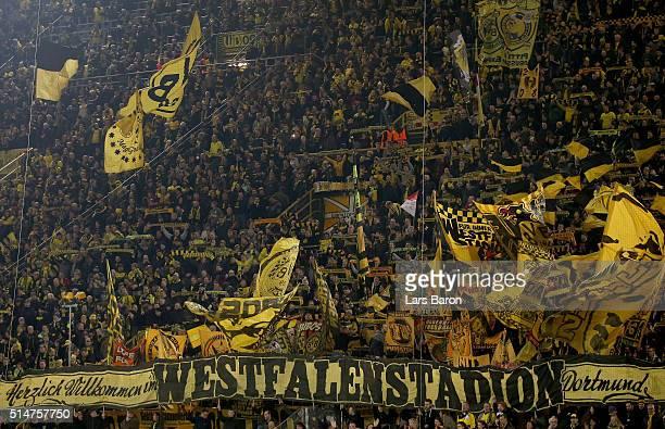 Fans of Dortmund are seen during the UEFA Europa League Round of 16 first leg match between Borussia Dortmund and Tottenham Hotspur at Signal Iduna...