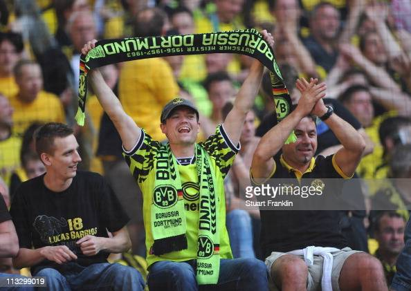 Fans of Dortmund celebrate after their team wins the league title at the end of the Bundesliga match between Borussia Dortmund and 1 FC Nuernberg at...