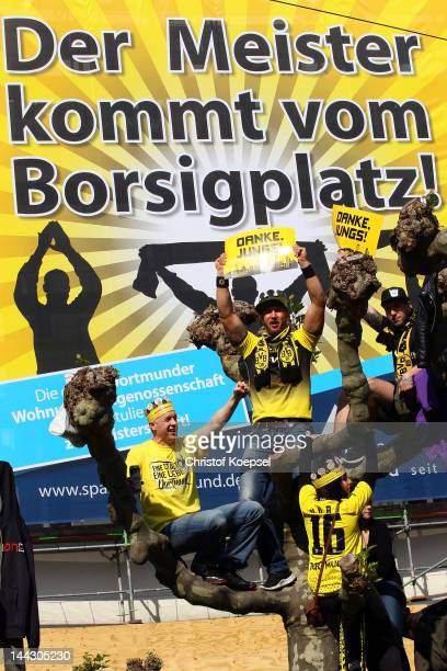 Fans of Dortmund celebrate during a parade at Borsigplatz celebrating Borussia Dortmund's Bundesliga and DFB Cup win on May 13 2012 in Dortmund...