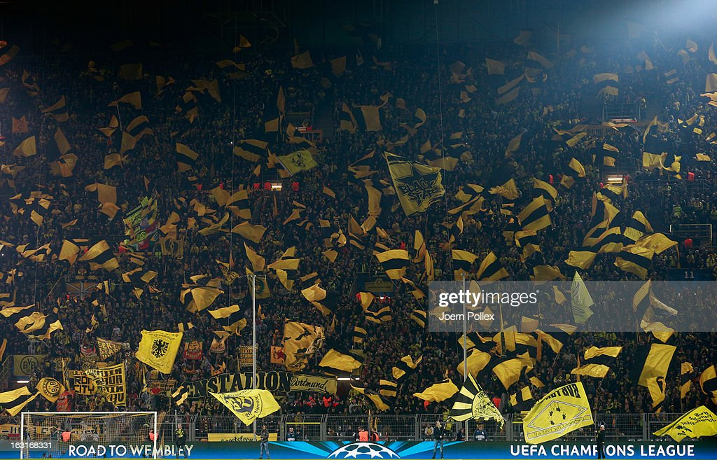Fans of Dortmund celebrate prior to the UEFA Champions League round of 16 leg match between Borussia Dortmund and Shakhtar Donetsk at Signal Iduna Park on March 5, 2013 in Dortmund, Germany.