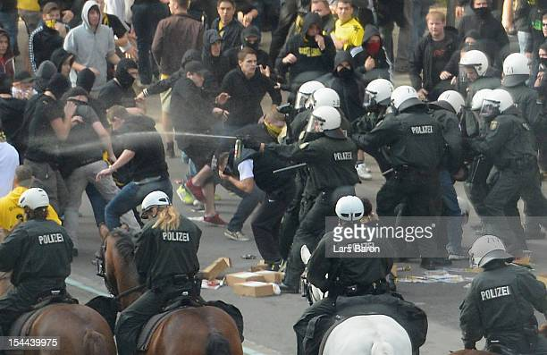 Fans of Dortmund clash with riot police prior to the Bundesliga match between Borussia Dortmund and FC Schalke 04 at Signal Iduna Park on October 20...