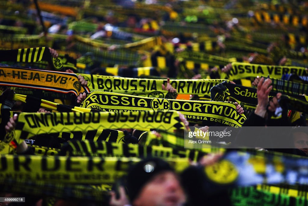 Fans of Dortmund hold up their scarfs during the Bundesliga match between Borussia Dortmund and 1899 Hoffenheim at Signal Iduna Park on December 5...