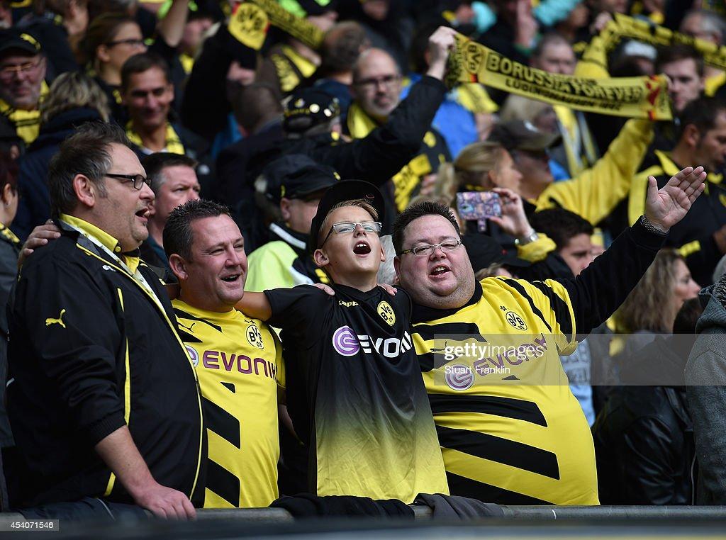 Fans of Dortmund sing during the Bundesliga match between Borussia Dortmund and Bayer 04 Leverkusen at Signal Iduna Park on August 23, 2014 in Dortmund, Germany.