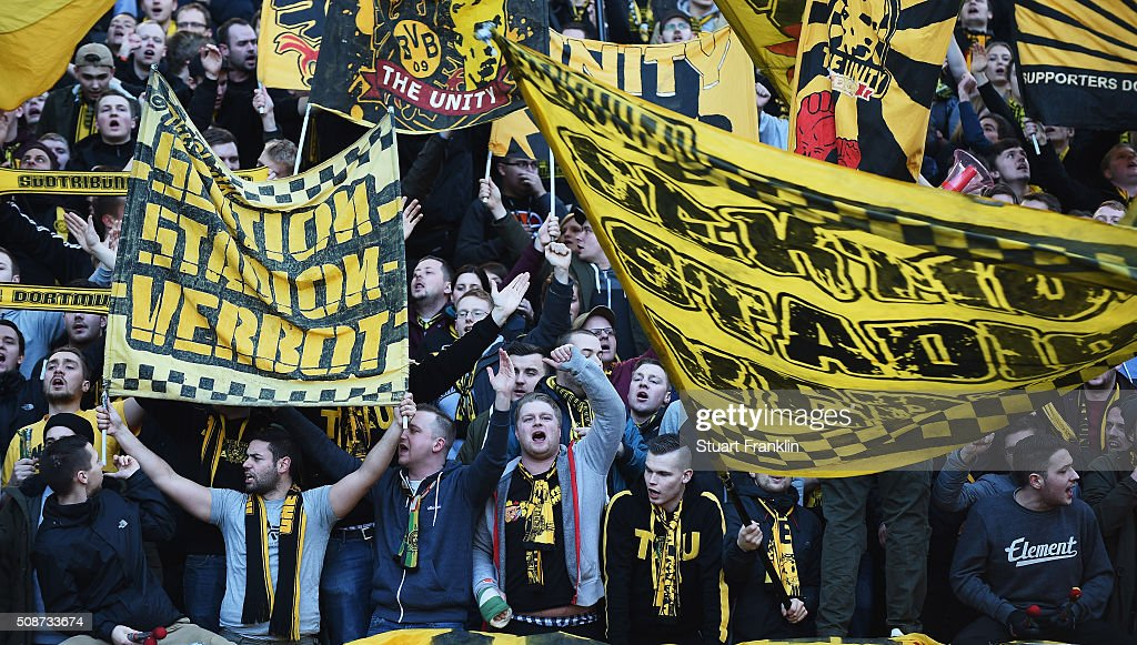 Fans of Dortmund sing during the Bundesliga match bewteen Hertha BSC and Borussia Dortmund at Olympiastadion on February 6, 2016 in Berlin, Germany.