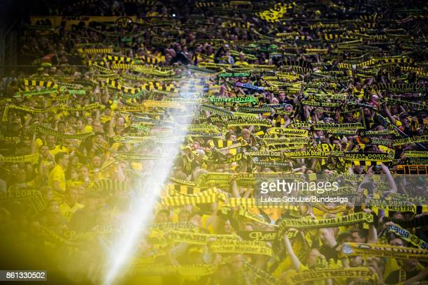 Fans of Dortmund support their team with their scarfs prior to the Bundesliga match between Borussia Dortmund and RB Leipzig at Signal Iduna Park on...
