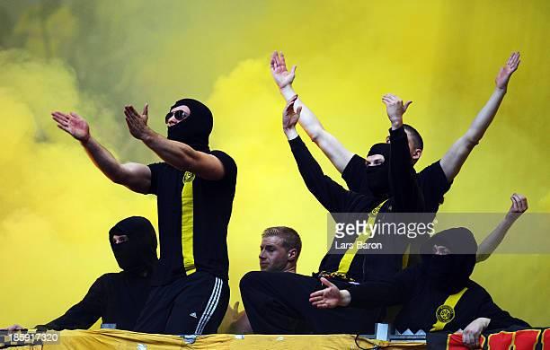 Fans of Dortmund trow flares and firework prior to the Bundesliga match between FC Schalke 04 and Borussia Dortmund at VeltinsArena on October 26...