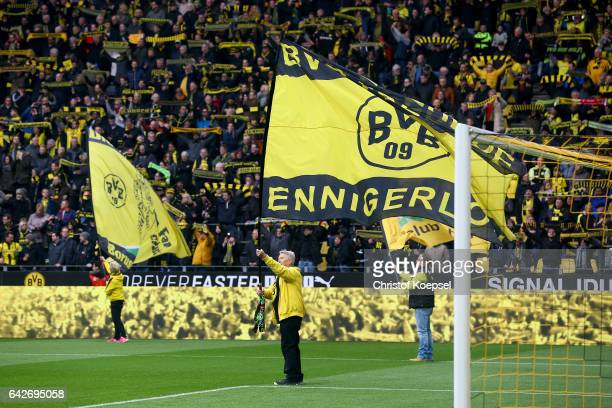 Fans of Dortmund wave flags prior to the Bundesliga match between Borussia Dortmund and VfL Wolfsburg at Signal Iduna Park on February 18 2017 in...