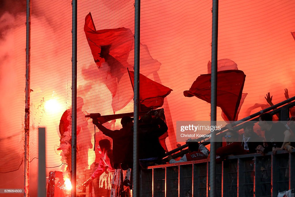 Fans of Duesseldorf fire a smoke bomb during the 2. Bundesliga match between MSV Duisburg and Fortuna Duesseldorf at Schauinsland-Reisen-Arena on April 29, 2016 in Duisburg, Germany.