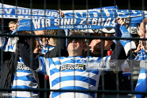 Fans of Duisburg hold a scarf during the third League match between MSV Duisburg and RW Erfurt at SchauinslandReisenArena on November 8 2014 in...