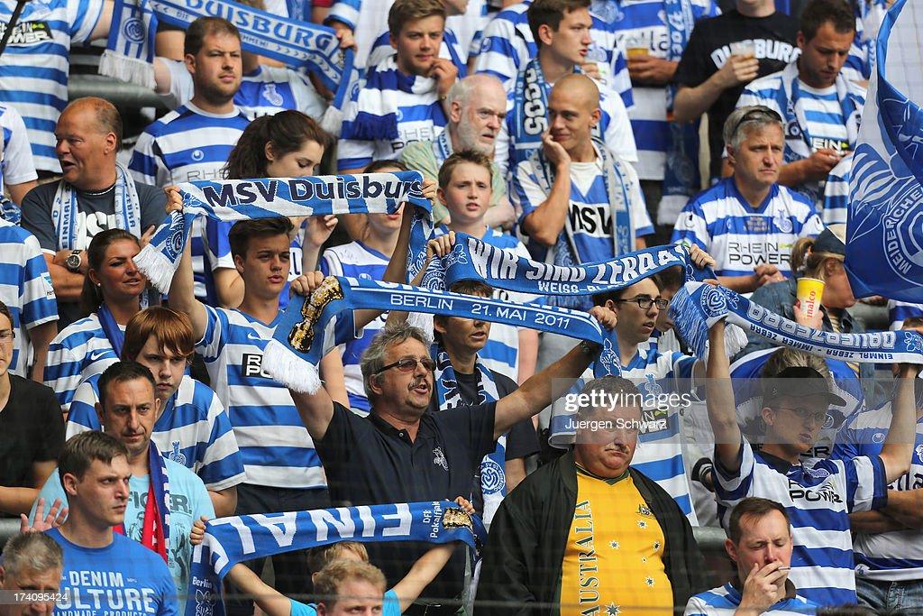 Fans of Duisburg support their team during the 3rd league match between MSV Duisburg and 1 FC Heidenheim at SchauinslandReisenArena on July 20 2013...