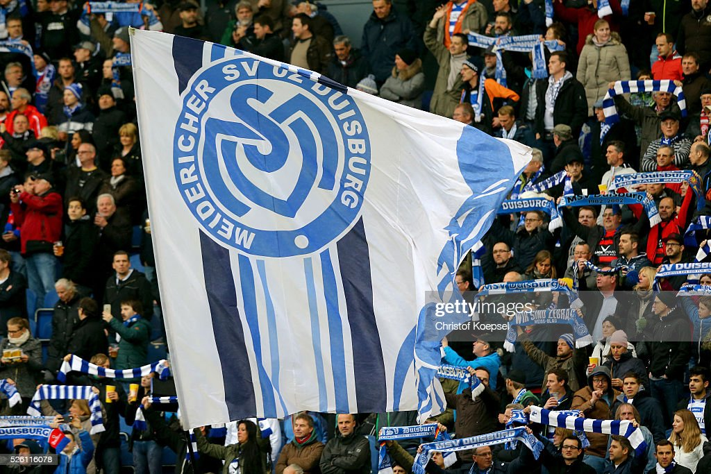 Fans of Duisburg wave a flag during the 2. Bundesliga match between MSV Duisburg and Fortuna Duesseldorf at Schauinsland-Reisen-Arena on April 29, 2016 in Duisburg, Germany.