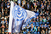 Fans of Duisburg wave flags prior to the third League match between MSV Duisburg and RW Erfurt at SchauinslandReisenArena on November 8 2014 in...