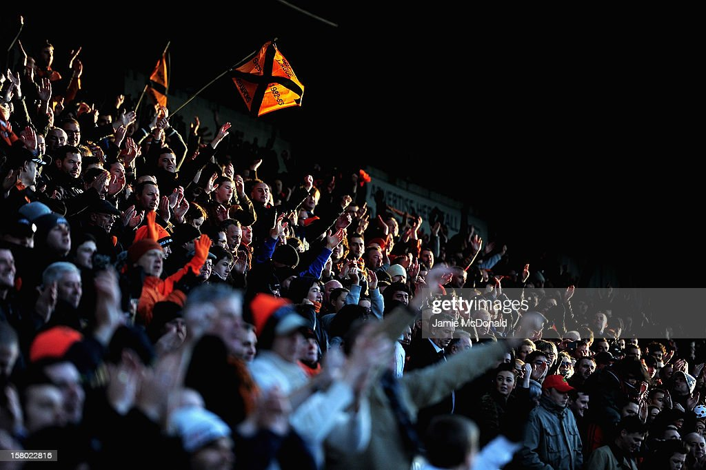 Fans of Dundee United enjoy the match during the Clydesdale Bank Premier League match between Dundee and Dundee United at Dens Park Stadium on December 9, 2012 in Dundee, Scotland.