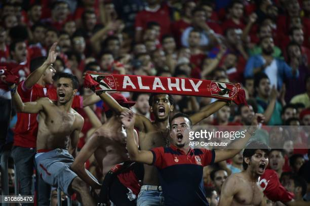 Fans of Egypt's Al Ahly cheer on their team during their African Champions League group stage football match with Cameroon's Cotonsport at Borg...
